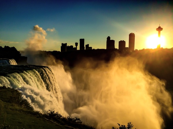 Niagara Falls with the view of Canada at sunset in Buffalo, New York.